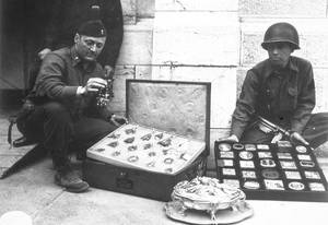 "Photo - This photo provided by The Monuments Men Foundation for the Preservation of Art of Dallas, shows Monuments Man James Rorimer, left, and Sgt. Antonio Valim examining valuable art objects at Neuschwanstein Castle in Germany which were stolen from the Rothschild collection in France by the ERR and found in the castle in May of 1945. Rorimer, a curator at the Metropolitan Museum of Art before the war who eventually became its director after returning, went on to achieve great success, helping to discover where works of art looted by the Nazis were tucked away across Europe. In the upcoming movie ""The Monuments Men,"" Matt Damon portrays a character inspired by the real-life Rorimer, who died in 1966 at the age of 60.  (AP Photo/National Archives and Records Administration)"