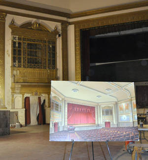 Photo -   This Nov. 17, 2012 photo shows an artist rendering of the eventual restoration of the State Theatre on an easel inside the Sioux Falls, S.D., theater. The circa-1926 theater, closed since 1991, has been raising funds for its renovation and plans to begin showing movies again in 2013. (AP Photo/Dirk Lammers)3