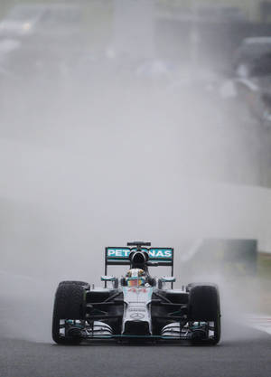Photo - Britain's Lewis Hamilton of Mercedes   drives his car during qualification ahead of the British Formula One Grand Prix at Silverstone circuit, Silverstone, England, Saturday, July 5, 2014. Hamilton finished sixth, Germany's Nico Rosberg of Mercedes won the pole position, Germany's Sebastian Vettel of Red Bull finished second and Britain's Jenson Button of McLaren Mercedes finished third. The British Formula One Grand Prix will be held on Sunday July 6, 2014. (AP Photo/Lefteris Pitarakis)