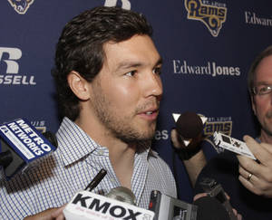 Photo - St. Louis Rams quarterback Sam Bradford answers questions during a news conference where Jeff Fisher was officially introduced as the new head football coach of the St. Louis Rams NFL team, in St. Louis, Tuesday, Jan. 16, 2012. (AP Photo/Tom Gannam) ORG XMIT: MOTG109