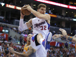 photo - Los Angeles Clippers' Blake Griffin gets a rebound in the first half of an NBA basketball game against the Phoenix Suns in Los Angeles, Saturday, Dec. 8, 2012. (AP Photo/Jae C. Hong)