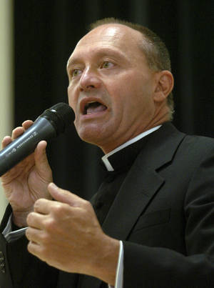 Photo - FILE - In this May 4, 2006 file photo, Monsignor Kevin Wallin speaks at the Catholic Center, headquarters of the Diocese of Bridgeport, in Bridgeport, Conn.  Wallin, of Waterbury, Conn., pleaded guilty Tuesday, April 2, 2013, in federal court in Hartford, to conspiracy to possess with intent to distribute methamphetamine. He had been accused of making more than $300,000 in methamphetamine sales out of his apartment, and running an adult video and sex toy shop.  Wallin, who resigned as pastor of St. Augustine Parish in Bridgeport in 2011, is scheduled to be sentenced June 25.  (AP Photo/Connecticut Post) MAGS OUT; MANDATORY CREDIT