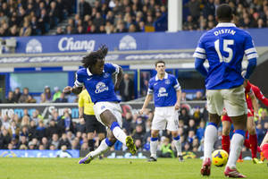 Photo - Everton's Romelu Lukaku, centre left, scores against Liverpool during their English Premier League soccer match at Goodison Park Stadium, Liverpool, England, Saturday Nov. 23, 2013. (AP Photo/Jon Super)
