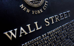 Photo - FILE - This Jan. 4, 2010 file photo shows an historic marker on Wall Street in New York. The stock market drifted lower Tuesday, June 10, 2014, after major indexes reached another record high the day before. (AP Photo/Mark Lennihan, File)
