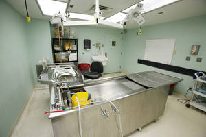 Photo - Autopsy table at the state medical examiner's office in Oklahoma City. Photo by Steve Gooch, The Oklahoman