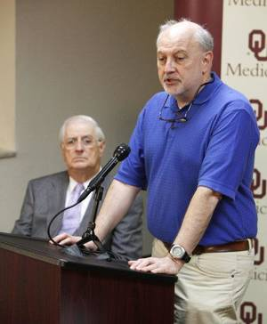 Photo - William McShan, Ph.D., with the OU College of Pharmacy, discusses ongoing research into rapidly mutating bacteria, during a press conference at the OU Health Sciences Center. Behind him is Joseph Ferretti, Ph.D., researcher with the OU College of Medicine. <strong>PAUL HELLSTERN</strong>