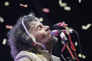 Photo - The Flaming Lips lead singer Wayne Coyne performs at Dfest in Tulsa July 27, 2007. ADAM WISNESKI/TULSA WORLD
