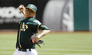 Photo - Oakland Athletics pitcher Jesse Chavez delivers a pitch during a baseball game against the Houston Astros in Oakland, Calif. on Sunday, April 20, 2014. (AP Photo/Matthew Sumner)