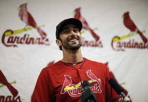 Photo - St. Louis Cardinals' Matt Carpenter speaks at a news conference at the team's spring training baseball facility, Saturday, March 8, 2014, in Jupiter, Fla. The Cardinals announced Saturday that they have agreed to a six-year contract extension with Carpenter for $52 million. (AP Photo/David Goldman)
