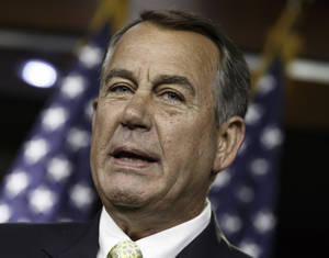 Photo - House Speaker John Boehner of Ohio talks to reporters during a news conference on Capitol Hill in Washington, Thursday, June 19, 2014. Boehner and congressional leaders met with President Barack Obama yesterday about the ongoing crisis in Iraq. The speaker charged that terrorism and the unrest in the Middle East had worsened during Obama's term. (AP Photo/J. Scott Applewhite)