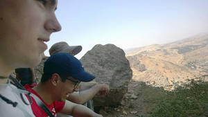 Photo - In this 2014 photo provided by Michigan State University, students in the school's Summer Study Abroad Program take a break while hiking in Israel. Some U.S. colleges have now pulled students from their overseas study programs in Israel as the Gaza war rages. Colleges site security as the top concern. (AP Photo/Michigan State University)