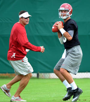 Photo -   FILE - This Aug. 3, 2012 file photo shows Alabama offensive coordinator Doug Nussmeier watching as quarterback AJ McCarron throws during practice in Tuscaloosa, Ala. Alabama coach Nick Saban says Nussmeier has made tweaks that should make the passing game more explosive. (AP Photo/The Birmingham News, Mark Almond, File) MAGS OUT