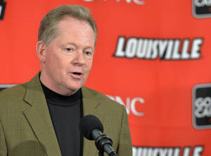 Photo - FILE - In this March 8, 2014 file photo, Louisville head football coach Bobby Petrino answers questions during a press conference in Louisville, Ky. Petrino's ongoing transition in his second stint as Louisville's coach continues Tuesday, March 18, 2014, with his first spring practice highlighted by filling several notable voids. (AP Photo/Timothy D. Easley, File)