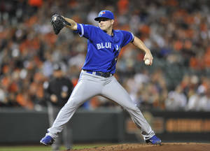 Photo -   Toronto Blue Jays pitcher Aaron Laffey delivers to a Baltimore Orioles batter during the first inning of a baseball game Tuesday, Sept. 25, 2012, in Baltimore. (AP Photo/Gail Burton)
