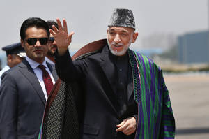 Photo - FILE - This May 26, 2014 file photo shows Afghan President Hamid Karzai in New Delhi, India. Civilian assistance to Afghanistan was always slated to shrink with America's military footprint, but U.S. aid officials were caught off-guard when Congress, upset by testy relations with Afghan President Hamid Karzai, slashed civilian aid by 50 percent this year. War-weary lawmakers, content with the level of Afghan aid already in the pipeline, backed the cut, but officials with the U.S. Agency for International Development warn that reducing aid too quickly is risky. (AP Photo/Saurabh Das, File)
