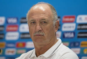 Photo - Brazil's coach Luiz Felipe Scolari attends a news conference the day before his team's round of 16 World Cup soccer match with Chile at the Mineirao Stadium in Belo Horizonte, Brazil, Friday, June 27, 2014. (AP Photo/Andre Penner)
