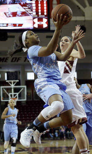 Photo - North Carolina guard Brittany Rountree, left, drives toward the basket past Boston College guard Lauren Engeln, right, in the first half of an NCAA college basketball game on Sunday, Jan. 19, 2014, in Boston. (AP Photo/Steven Senne)