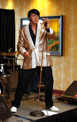 Photo - Elvis impersonator Brent Giddens performs at a safety conference Wednesday.  Photo by Steve Sisney, THE OKLAHOMAN