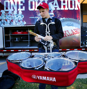 Photo - Brandon Green, a freshman from Frisco, Texas, prepares his drums as the University of Oklahoma band plays Friday on new Yamaha instruments.  Photo by Steve Sisney, The Oklahoman <strong>STEVE SISNEY</strong>