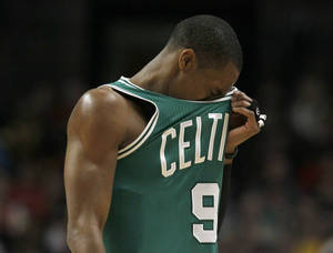 Photo - Boston Celtics point guard Rajon Rondo reacts during the second half of an NBA basketball game against the Chicago Bulls, Thursday, Feb. 16, 2012, in Chicago. The Bulls won 89-80. (AP Photo/Charles Rex Arbogast) ORG XMIT: CXA110