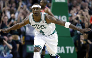 Photo - Boston Celtics' Jason Terry (4) reacts to his 3-pointer in overtime during an NBA basketball game against the Atlanta Hawks in Boston, Friday, March 8, 2013. The Celtics won 107-102. (AP Photo/Michael Dwyer) ORG XMIT: MAMD106