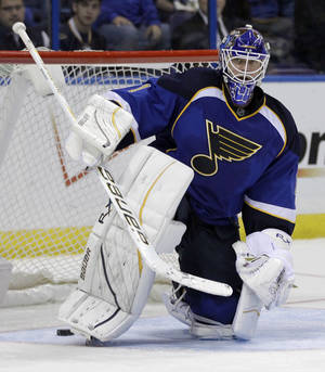 Photo -   St. Louis Blues goalie Brian Elliott gets up after allowing a goal by Phoenix Coyotes' Mikkel Boedker, of Denmark, during the third period of an NHL hockey game on Friday, April 6, 2012, in St. Louis. The Coyotes won 4-1. (AP Photo/Jeff Roberson)