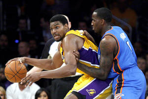 photo - Kendrick Perkins (5) defends against Los Angeles&#039; Andrew Bynum (17) during Game 3 in the second round of the NBA basketball playoffs between the L.A. Lakers and the Oklahoma City Thunder at the Staples Center in Los Angeles, Friday, May 18, 2012. Photo by Nate Billings, The Oklahoman