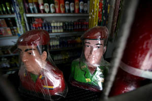 Photo - Plastic wrapped busts of Venezuela's late President Hugo Chavez sit for sale at a market in Moron, Venezuela, Thursday, April 25, 2013.  Venezuelan opposition leader Henrique Capriles said Thursday the opposition would go to the Supreme Court to challenge the results of the April 14 presidential vote, which was narrowly won by Chavez's political heir, Nicolas Maduro.  (AP Photo/Fernando Llano)