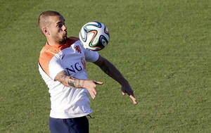 Photo - Wesley Sneijder of the Netherlands watches the ball during a training session in Rio de Janeiro, Brazil, Sunday, June 15, 2014.  The Netherlands play in group B of the 2014 soccer World Cup. (AP Photo/Wong Maye-E)