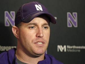 Photo - FILE - In this April 1, 2014, file photo, Northwestern football coach Pat Fitzgerald speaks at a news conference after his football team participated in an NCAA college spring practice in Evanston, Ill. The offseason debate over whether college players should have the right to unionize are fading as Northwestern gets ready to begin its season, hosting California on Aug. 30. (AP Photo/M. Spencer Green, File)