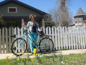 Photo - Norman artist Debbie Kaspari designed two of the winning submissions in the Public Arts Board of Norman Bike Rack Project. She enjoys riding her mint green Giant bike around Norman, and especially the Norman Farmers Market.  Photo by Chris Jones, for The Oklahoman
