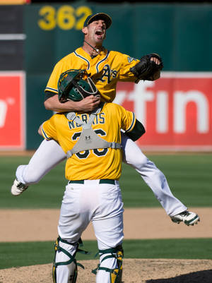 Photo -   Oakland Athletics closer Grant Balfour celebrates with catcher Derek Norris after getting the last out in the team's 12-5 win over the Texas Rangers in a baseball game Wednesday, Oct. 3, 2012, in Oakland, Calif. The A's took the AL West title. (AP Photo/The Sacramento Bee, Jose Luis Villegas) MAGS OUT; TV OUT (KCRA3, KXTV10, KOVR13, KUVS19, KMAZ31, KTXL40) MANDATORY CREDIT