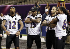 photo - Baltimore Ravens wide receiver Jacoby Jones (12), LaQuan Williams (15), Tommy Streeter (11) and BTorrey Smith during media day for the NFL Super Bowl XLVII football game Tuesday, Jan. 29, 2013, in New Orleans. (AP Photo/Pat Semansky)