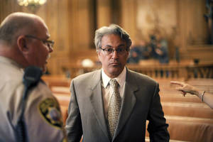 photo -   Suspended San Francisco Sheriff Ross Mirkarimi arrives at a Board of Supervisors meeting on Tuesday, Oct. 9, 2012, in San Francisco. The supervisors planned to vote on removing Mirkarimi from office following a domestic violence incident between Mirkarimi and his wife Eliana Lopez. (AP Photo/Noah Berger)