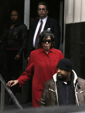 photo - Former U.S. congresswoman Carolyn Cheeks Kilpatrick exits the Theodore Levin Federal U.S. Courthouse in Detroit, Monday, March 11, 2013. Her son, former Detroit Mayor Kwame Kilpatrick was convicted Monday of corruption charges and then sent to jail to await his prison sentence in yet another dramatic setback for a man who once was among the nation&#039;s youngest big-city leaders. Jurors convicted Kilpatrick of a raft of crimes, including racketeering conspiracy, which carries a maximum punishment of 20 years behind bars. Kilpatrick&#039;s long-time contractor friend, Bobby Ferguson was found guilty of 9 of 11 racketeering and extortion counts. Kwame Kilpatrick&#039;s father, Bernard Kilpatrick was convicted of 1 of 4 counts, including filing a false tax return. (AP Photo/Paul Sancya)