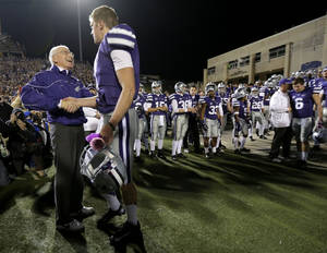 Photo - Kansas State coach Bill Snyder, left, talks to quarterback Collin Klein during a senior day recognition before an NCAA college football game against Texas, Saturday, Dec. 1, 2012, in Manhattan, Kan. (AP Photo/Charlie Riedel)