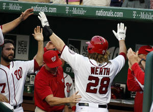Photo - Washington Nationals' Jayson Werth (28) celebrates with his teammates including starting pitcher Tanner Roark, left, during the third inning of an interleague baseball game against the Houston Astros at Nationals Park Tuesday, June 17, 2014, in Washington. (AP Photo/Alex Brandon)