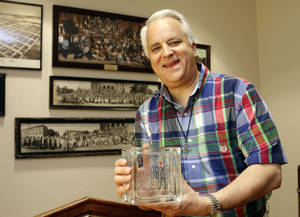 Photo -  The Rev. Mark McAdow, senior pastor of First United Methodist Church of Oklahoma City, shows a commemorative glass block created in celebration of the church's 125th anniversary, which will be observed Sunday at 131 NW 4. Photo by Paul Hellstern, The Oklahoman  <strong>PAUL HELLSTERN</strong>