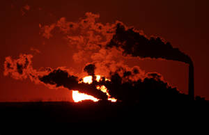 Photo - In this March 8, 2014 file photo steam from the Jeffrey Energy Center coal-fired power plant is silhouetted against the setting sun near St. Marys, Kan. As President Barack Obama prepares to announce tougher new air quality standards affecting coal-fired power plants, lawmakers in about a half-dozen state already have acted pre-emptively. Not to toughen their own standards, but to make it tougher to enforce the new federal ones. (AP Photo/Charlie Riedel, File)