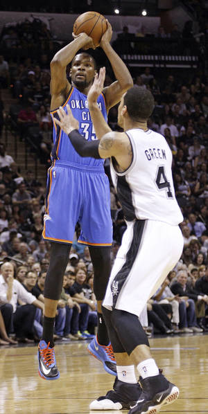 Photo - Oklahoma City's Kevin Durant (35) shoots against San Antonio's Danny Green (4) during Game 5 of the Western Conference Finals in the NBA playoffs between the Oklahoma City Thunder and the San Antonio Spurs at the AT&T Center in San Antonio, Thursday, May 29, 2014. Photo by Sarah Phipps, The Oklahoman