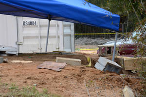 photo - In this undated photo released by the FBI on Tuesday, Feb. 5, 2013, a tent covers the bunker where where a 5-year-old child was held for a week by Jimmy Lee Dykes in Midland City, Ala. The boy was rescued and his captor was killed when federal agents raided the bunker on Monday. (AP Photo/FBI)