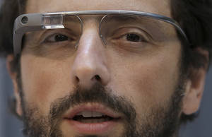 Photo - Google co-founder Sergey Brin wears Google Glass glasses at an announcement for the Breakthrough Prize in Life Sciences at Genentech Hall on UCSF's Mission Bay campus in San Francisco, Wednesday, Feb. 20, 2013. (AP Photo/Jeff Chiu)