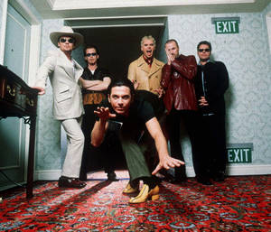 Photo -   FILE - in this 1997 file photo, members of the Australian rock band INXS pose for a group portrait at the Ritz Carleton Hotel in Aspen. Colo. They are, from left, Tim Farriss, Kirk Pengilly, Michael Hutchence, foreground, Jon Farriss, Garry Gary Beers and Andrew Farriss. Drummer Farriss announced the end of the band's remarkable run of performances during a concert in the West Australia city of Perth earlier in the week of Nov. 11, 2102. The band later confirmed the news in a statement. (AP Photo/James Minchin, File)