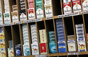 Photo - During the holiday season as people prepare their New Year's resolutions, many people consider quitting smoking. The health benefits can be immediate. <strong>Mark Lennihan - AP</strong>