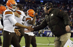 Photo - Cleveland Browns head coach Rob Chudzinski, right, congratulates  quarterback Jason Campbell after his touchdown pass to Jordan Cameron in the fourth quarter of an NFL football game against the New England Patriots, Sunday, Dec. 8, 2013, in Foxborough, Mass. (AP Photo/Steven Senne)