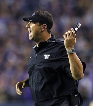 Photo -   Washington head coach Steve Sarkisian yells from the sidelines in the second half of an NCAA college football game on Saturday, Sept. 1, 2012, in Seattle. Washington won 21-12. (AP Photo/Elaine Thompson)