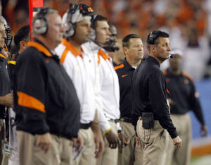 photo - COLLEGE FOOTBALL: Oklahoma State coach Mike Gundy watches the game during the Fiesta Bowl between the Oklahoma State University Cowboys (OSU) and the Stanford Cardinals at the University of Phoenix Stadium in Glendale, Ariz., Tuesday, Jan. 3, 2012. Photo by Sarah Phipps, The Oklahoman