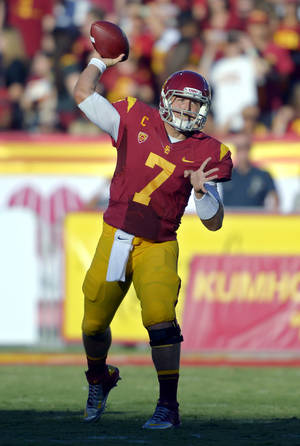 Photo -   Southern California quarterback Matt Barkley passes during the first half of their NCAA college football game against Hawaii, Saturday, Sept. 1, 2012, in Los Angeles. (AP Photo/Mark J. Terrill)