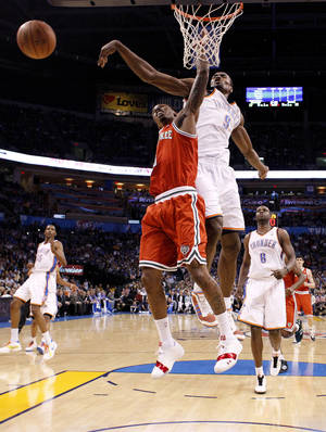 Photo - Oklahoma City's Serge Ibaka (9) blocks the shot of Milwaukee's Brandon Jennings (3) during the NBA basketball game between the Oklahoma City Thunder and the Milwaukee Bucks at the Oklahoma City Arena, Wednesday, April 13, 2011. Photo by Bryan Terry, The Oklahoman