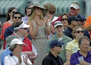Photo - Skier Lindsey Vonn applauds as she watches Tiger Woods  during the first round of the Masters golf tournament Thursday, April 11, 2013, in Augusta, Ga. (AP Photo/Matt Slocum)